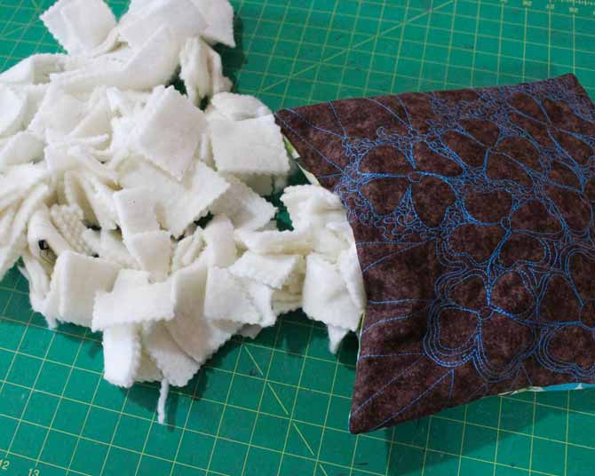 Use cut up scraps of batting to stuff the cushion