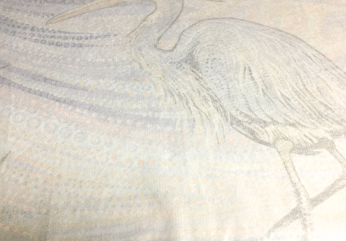 Sulky Soft'n Sheer Extra cut away stabilizer has been ironed to the wrong side of the Water Garden blue heron panel from Northcott. A tutorial on thread painting using SCHMETZ needles/ Gütermann threads / Northcott fabric