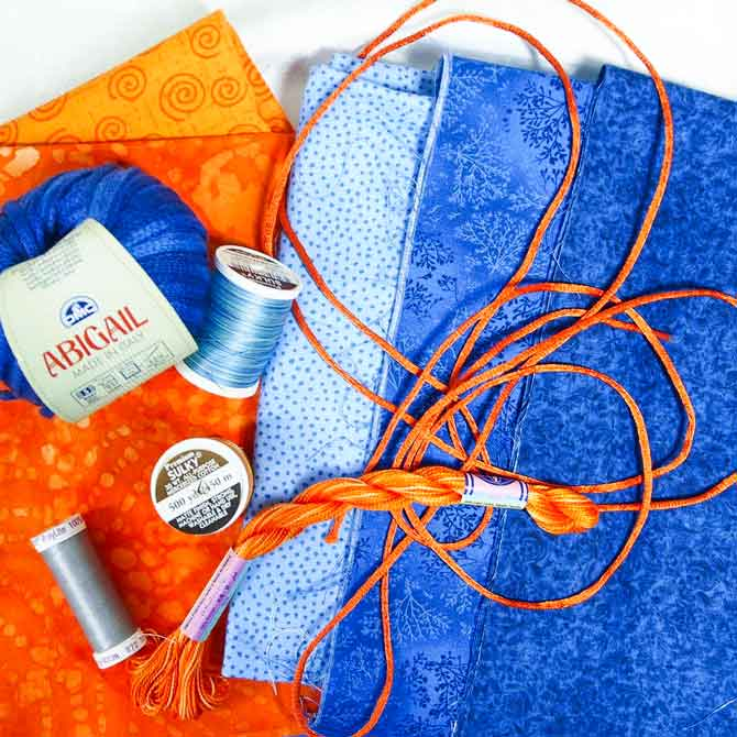 A complementary color scheme of supplies in blue and orange