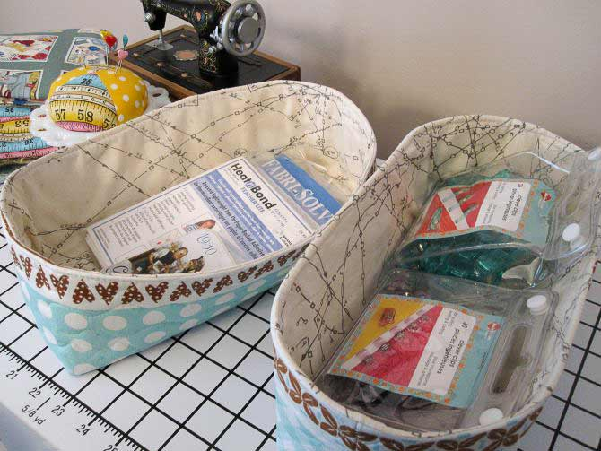 Fabric baskets fit the Studio Collection Sewing and Design Table's shelves perfectly.