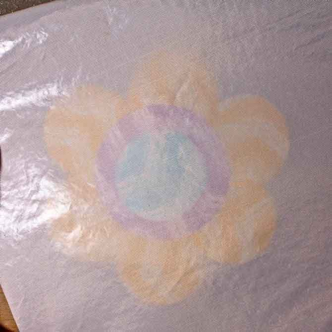 Second pressing sheet on top of flower