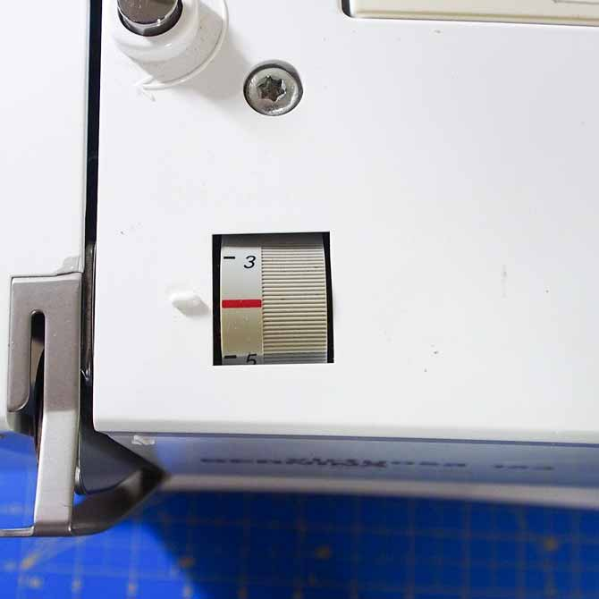 photo of an upper tension dial on a sewing machine
