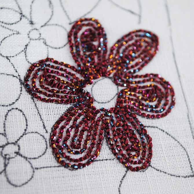 The back of the punchneedle piece shows how the lines of stitching done with the Dazzle thread from WonderFil are placed a needle's width apart.