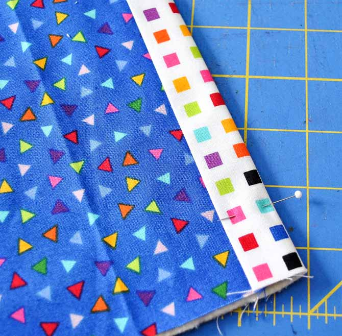 The edge of the lining fabric is double folded over the edge of the outside fabric