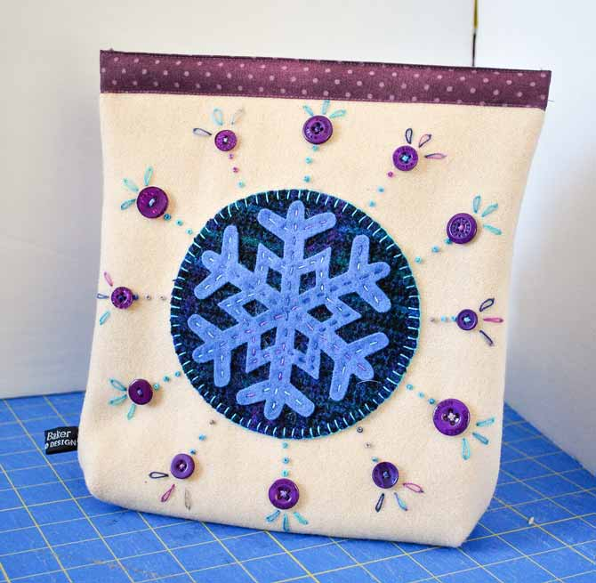 The finished wool applique snap bag