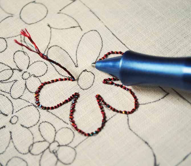 The first punchneedle stitches done with the Dazzle thread from WonderFil Specialty threads. Look at those sparkles! Even from the back of the fabric.