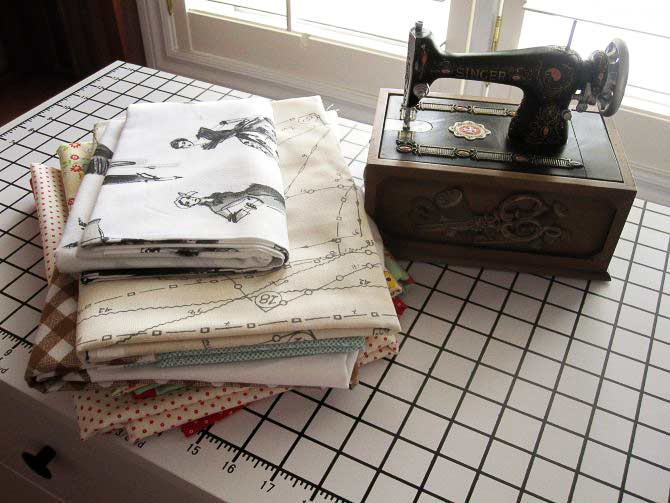 The table top of the Studio Collection Sewing and Design table has a measuring grid.
