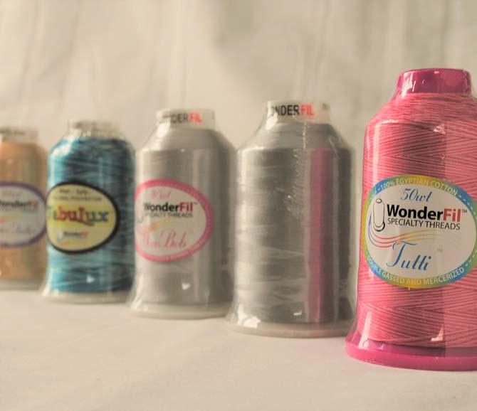 The five WonderFil longarm threads.