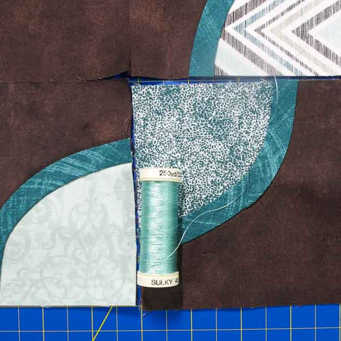 A light teal rayon thread to add contrast and shine to the bias tape