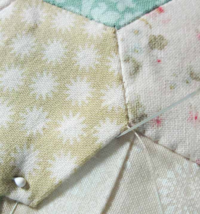 Small stitches close to the edge of the flower petal applique shape. WonderFil Specialty Threads.