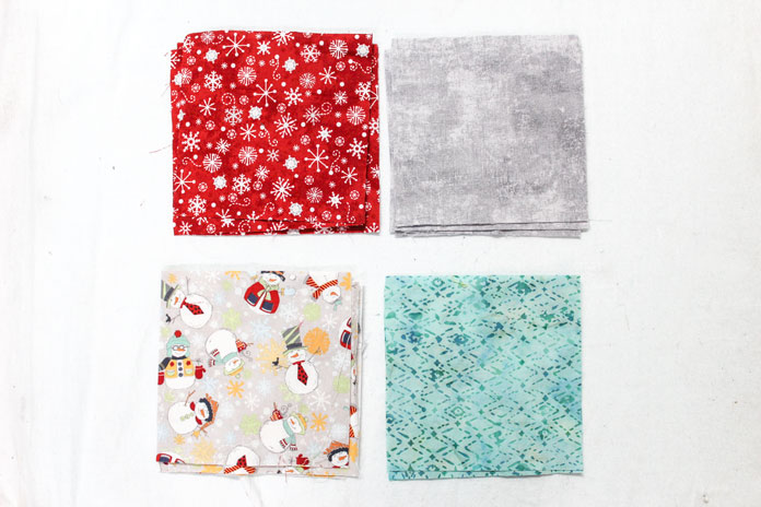 "Pick four different fabrics and cut three 6"" squares."