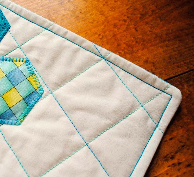"Topstitch 1/2"" from the edges of the finished pillow."