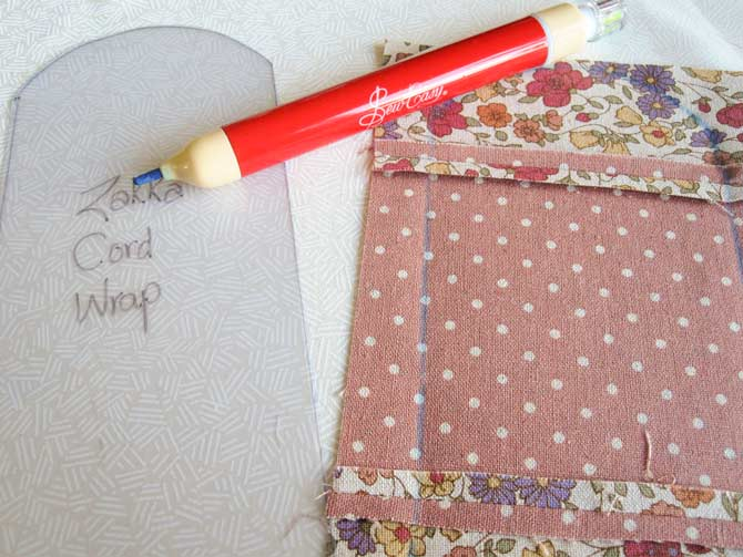 Trace the template onto the wrong side of the pieced fabric, using a chalk marker.