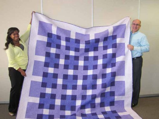 "Michelle and I with her wedding quilt. The pattern for this quilt, Transparency, is from the book ""Quilt Made Modern"" by Weeks Ringle & Bill Kerr."