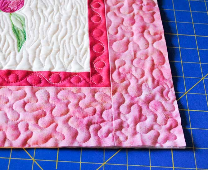 Trimming the edges of the quilt