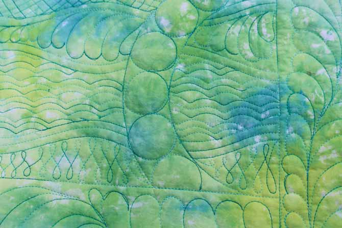 This is a Free Motion Quilting sample using WonderFil's cotton thread, Tutti. The colour is #22 Peacock