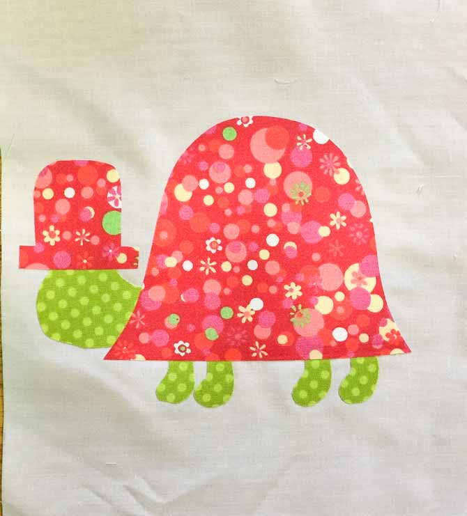 Fabric shaped turtle on white fabric background.