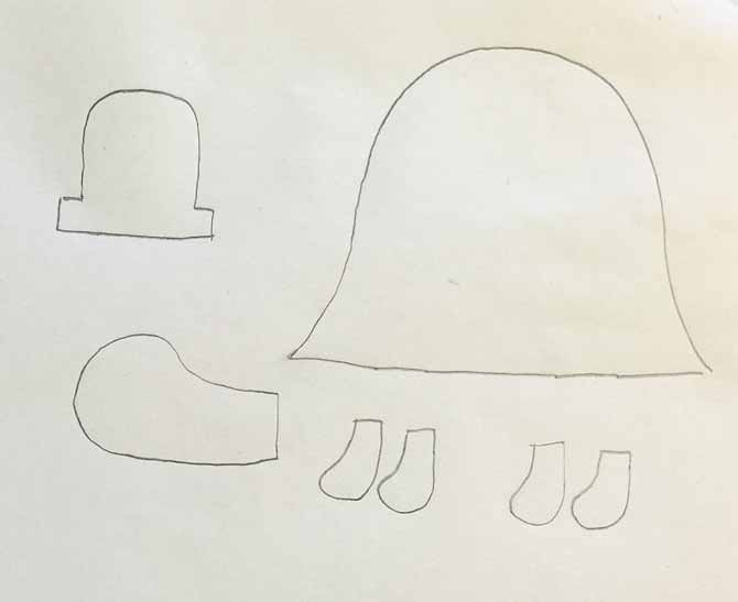 Shapes of a turtle including feet, shell, head and hat drawn on paper with a pencil.