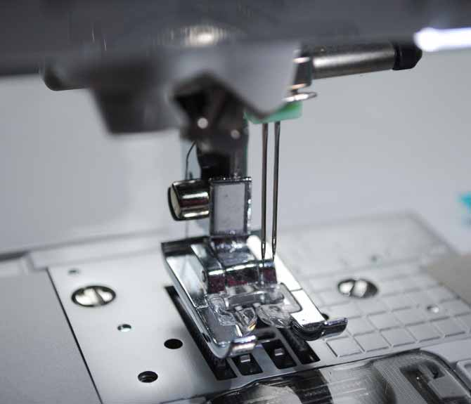 The twin needle is installed in the Brother NQ900 sewing machine.