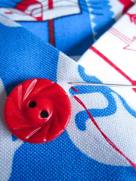 Place two or three small stitches at the pocket intersections prior to sewing a button onto the same spot.