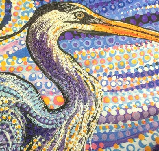 The neck, chest and head of the heron on the Artisan Spirit Water Garden panel have been accented with thread painting SCHMETZ / Sulky / Northcott