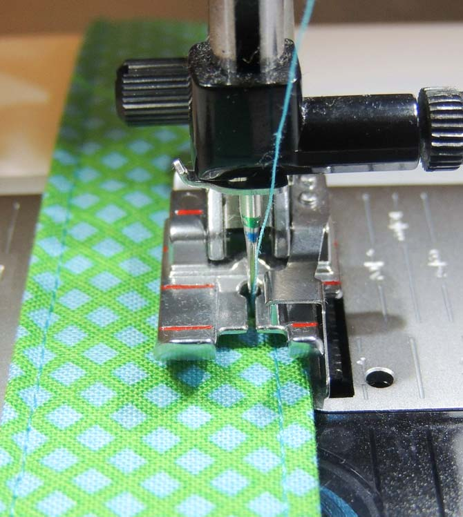 The topstitch presser foot was the perfect foot for keeping my topstitches neat and in a row on my bag handles.