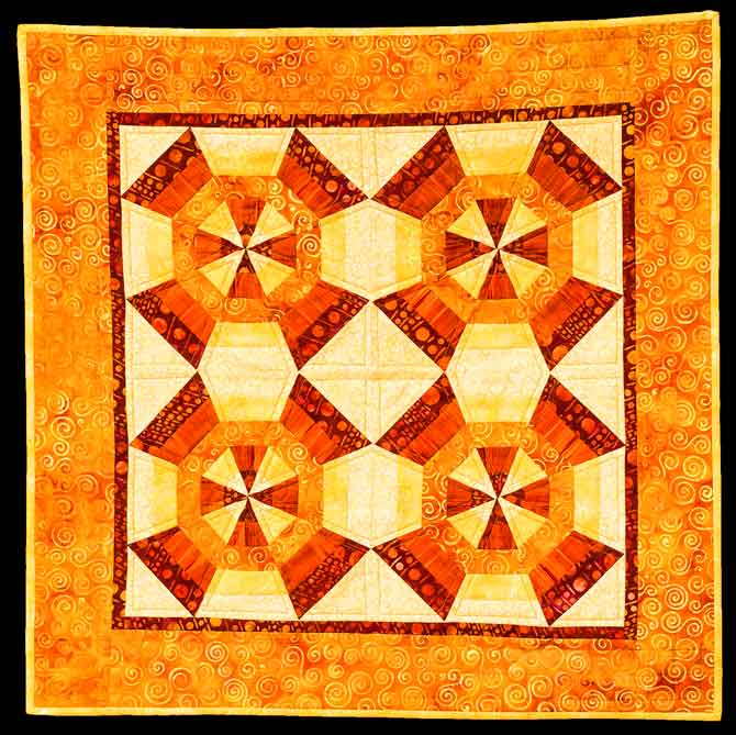 Kaleidoscope quilt in a warm monochromatic color scheme