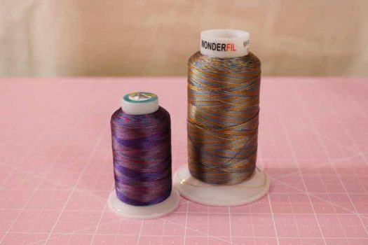The 2 different sizes of WonderFil's Mirage rayon thread.