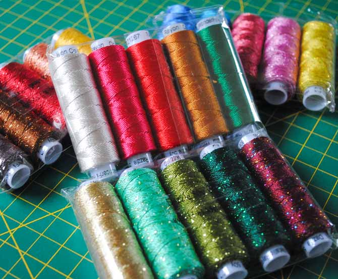Packages of Razzle and Dazzle threads from WonderFil Specialty threads.