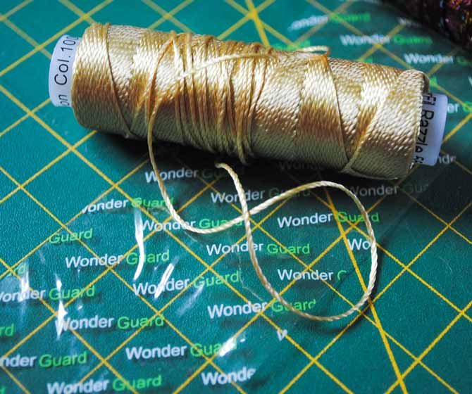 The unraveling Razzle and Dazzle threads are easily tamed by wrapping the spools with Wonder Guards.