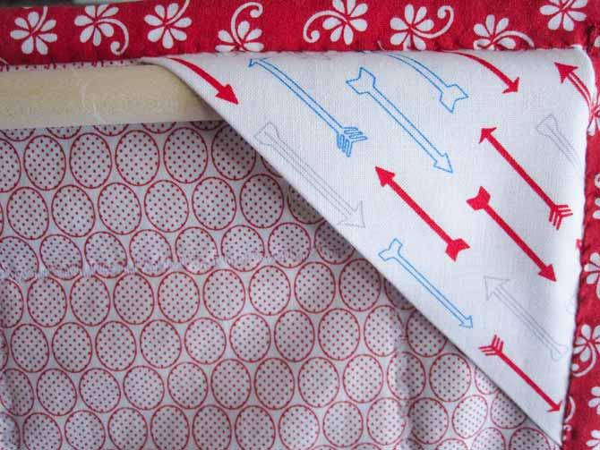 "Install a 1/2"" diameter wooden dowel between the folded corner hanging pockets."