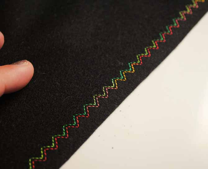 The NQ900 3 steps elastic zigzag stitch with the twin needle on black wool.