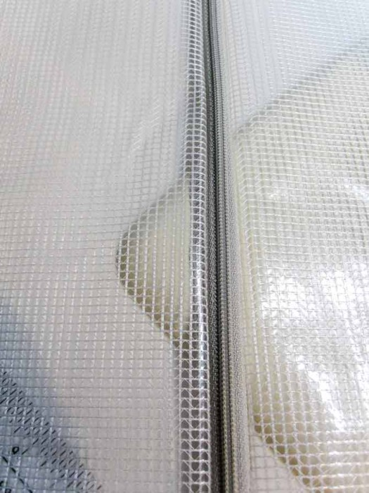 Zipper installed on the vinyl mesh pouch.